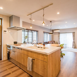 Design ideas for a small industrial single-wall open plan kitchen in Other with an integrated sink, medium wood cabinets, composite countertops, glass sheet splashback, stainless steel appliances, plywood flooring, a breakfast bar and white worktops.