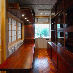 Huge transitional enclosed kitchen ideas - Example of a huge transitional u-shaped dark wood floor and multicolored floor enclosed kitchen design in Other with an undermount sink, red backsplash, wood backsplash, red countertops and red cabinets