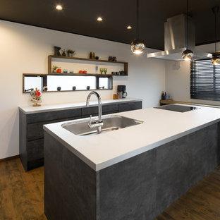 コンクリート調のキッチンを主役にしたカフェのようなLDK空間