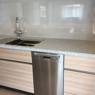 This is an example of a medium sized scandinavian galley open plan kitchen in Tokyo with a submerged sink, beaded cabinets, light wood cabinets, marble worktops, grey splashback, glass sheet splashback, stainless steel appliances, plywood flooring, an island and beige floors.