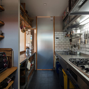 Asian single-wall separate kitchen in Other with a double-bowl sink, open cabinets, stainless steel benchtops, white splashback, porcelain splashback, stainless steel appliances, porcelain floors and black floor.