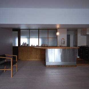 Photo of a contemporary l-shaped open plan kitchen in Osaka with a built-in sink, flat-panel cabinets, stainless steel cabinets, wood worktops, white splashback, porcelain splashback, integrated appliances, plywood flooring and an island.