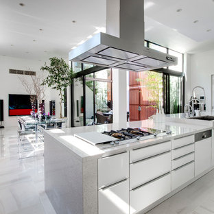 Large contemporary open concept kitchen remodeling - Large trendy single-wall marble floor and gray floor open concept kitchen photo in Tokyo with an undermount sink, flat-panel cabinets, white cabinets, terrazzo countertops, stainless steel appliances and an island