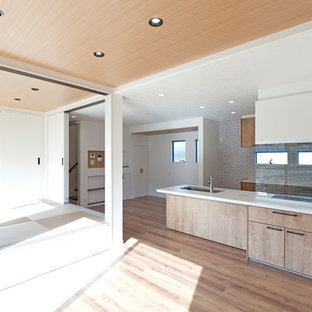 Design ideas for a medium sized modern single-wall open plan kitchen in Other with a single-bowl sink, beaded cabinets, beige cabinets, onyx worktops, white splashback, window splashback, integrated appliances, plywood flooring, an island, beige floors and white worktops.
