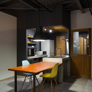 Photo of a small industrial single-wall open plan kitchen in Osaka with an undermount sink, open cabinets, grey cabinets, concrete benchtops, metallic splashback, concrete floors, with island, grey floor and grey benchtop.