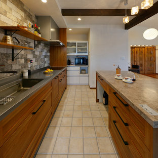 Inspiration for a midcentury kitchen in Other with a single-bowl sink, terra-cotta floors and beige floor.