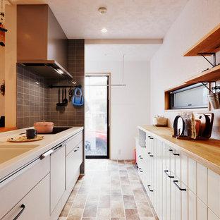 東京23区のミッドセンチュリースタイルのおしゃれなキッチンの写真