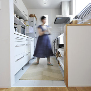 Scandinavian enclosed kitchen appliance - Enclosed kitchen - scandinavian single-wall vinyl floor and white floor enclosed kitchen idea in Other with an integrated sink, open cabinets and stainless steel countertops