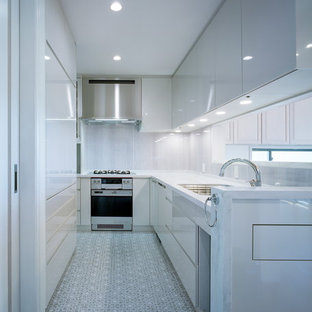Inspiration for a modern l-shaped separate kitchen in Kobe with a drop-in sink, beaded inset cabinets, white cabinets, solid surface benchtops, white splashback, limestone splashback, stainless steel appliances, vinyl floors, multi-coloured floor and grey benchtop.