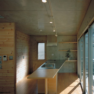 This is an example of a medium sized modern single-wall open plan kitchen in Tokyo with an integrated sink, open cabinets, stainless steel worktops, stainless steel appliances, plywood flooring, an island, beige floors and beige worktops.