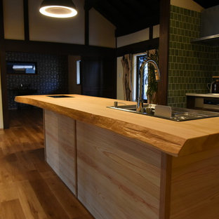 This is an example of a large asian galley open plan kitchen in Other with open cabinets, medium wood cabinets, wood benchtops, porcelain splashback, stainless steel appliances, medium hardwood floors and with island.