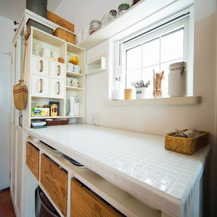 Photo of a small scandinavian galley kitchen in Other with open cabinets, white cabinets and tile benchtops.