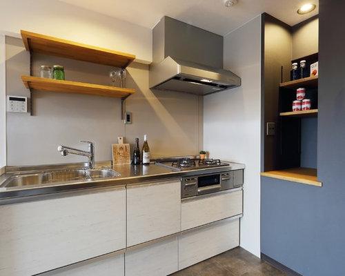 k chen mit beigefarbenen schr nken und edelstahl arbeitsplatte ideen bilder. Black Bedroom Furniture Sets. Home Design Ideas