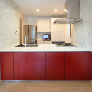 Rustic kitchen pictures - Example of a mountain style kitchen design in Tokyo with red backsplash and wood backsplash