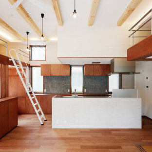 Asian open concept kitchen designs - Inspiration for a single-wall medium tone wood floor open concept kitchen remodel in Tokyo with flat-panel cabinets, brown cabinets, stainless steel countertops, multicolored backsplash, stainless steel appliances and an island