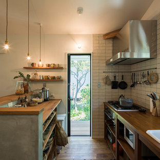 Small Industrial Open Concept Kitchen Inspiration   Small Urban Galley  Medium Tone Wood Floor And Brown