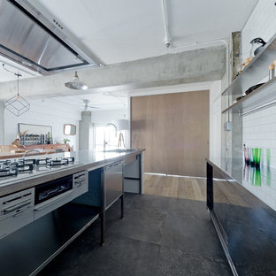 Mid-sized scandinavian open concept kitchen designs - Example of a mid-sized danish single-wall cement tile floor and gray floor open concept kitchen design in Kobe with a drop-in sink, open cabinets, stainless steel cabinets, stainless steel countertops and a peninsula