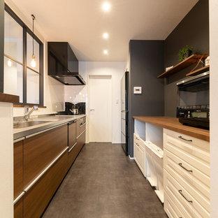 他の地域のミッドセンチュリースタイルのおしゃれなキッチン (一体型シンク、グレーの床) の写真
