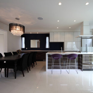 Mid-sized contemporary galley open plan kitchen in Yokohama with an undermount sink, flat-panel cabinets, black splashback, white appliances, with island and white floor.
