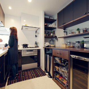 Traditional u-shaped kitchen in Nagoya with an integrated sink, flat-panel cabinets, brown cabinets, white splashback and stainless steel appliances.
