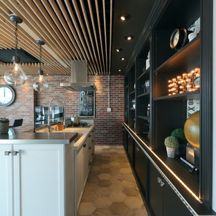 Photo of an industrial single-wall eat-in kitchen in Nagoya with an undermount sink, white cabinets, solid surface benchtops, terra-cotta floors and multi-coloured floor.
