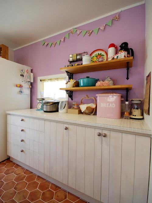 rustikale k chen mit arbeitsplatte aus fliesen ideen. Black Bedroom Furniture Sets. Home Design Ideas
