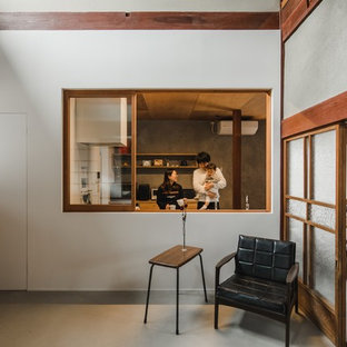 Inspiration for an expansive asian single-wall eat-in kitchen in Other with an integrated sink, open cabinets, light wood cabinets, stainless steel benchtops, white splashback, porcelain splashback, black appliances, concrete floors, with island, grey floor and grey benchtop.