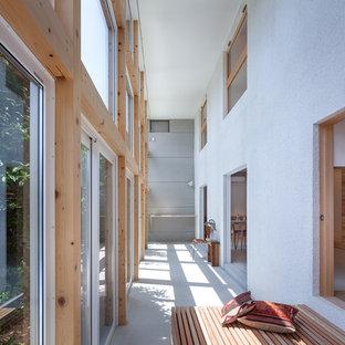 他の地域のラスティックスタイルのおしゃれなサンルーム (コンクリートの床、グレーの床) の写真
