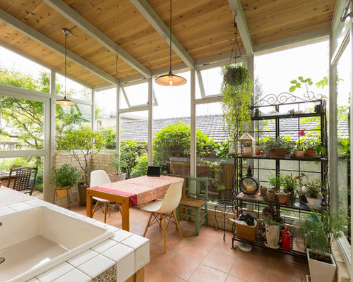 rustikaler wintergarten mit terrakottaboden ideen design bilder houzz. Black Bedroom Furniture Sets. Home Design Ideas