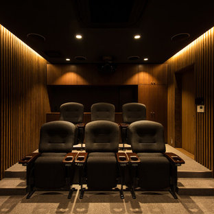 Design ideas for a large modern enclosed home theatre in Kyoto with brown walls, ceramic floors, a projector screen and grey floor.