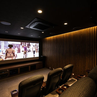 Photo of a large modern enclosed home theatre in Kyoto with brown walls, ceramic floors, a projector screen and grey floor.