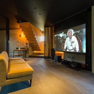 名古屋のコンテンポラリースタイルのおしゃれな独立型シアタールーム (グレーの壁、コンクリートの床、プロジェクタースクリーン、グレーの床) の写真
