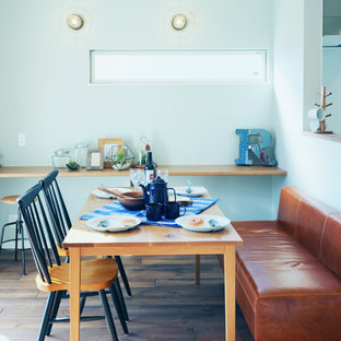 Inspiration for a coastal dining room in Tokyo Suburbs with white walls, medium hardwood flooring and brown floors.