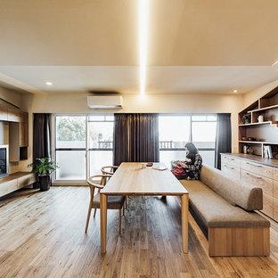 神戸のコンテンポラリースタイルのおしゃれなダイニング (無垢フローリング、茶色い床) の写真
