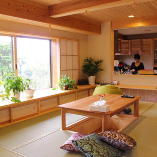 Example of a mid-sized zen tatami floor and green floor great room design in Other with beige walls