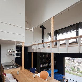 横浜のミッドセンチュリースタイルのおしゃれなLDK (白い壁) の写真