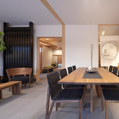 Example of a zen great room design in Kyoto with white walls