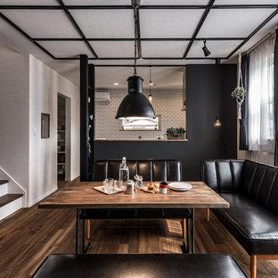 Urban medium tone wood floor and brown floor dining room photo in Fukuoka with white walls