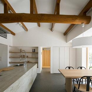 名古屋の北欧スタイルのおしゃれなLDK (白い壁、黒い床) の写真