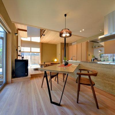 Great room - medium tone wood floor and brown floor great room idea in Yokohama with brown walls