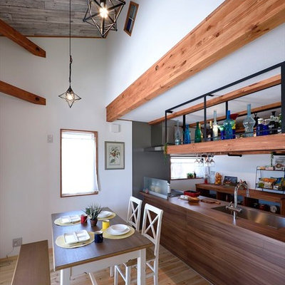 Great room - light wood floor and brown floor great room idea in Other with white walls
