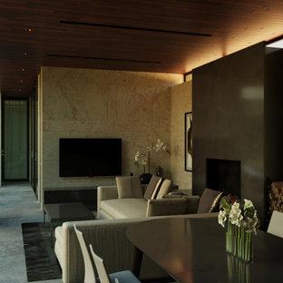 Idee per una sala da pranzo aperta verso il soggiorno etnica di medie dimensioni con pareti beige, pavimento in travertino, stufa a legna, cornice del camino in pietra e pavimento grigio