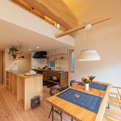 Asian medium tone wood floor and brown floor great room photo in Yokohama with white walls