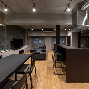 Inspiration for a modern open plan dining room in Tokyo with grey walls, painted wood flooring and brown floors.