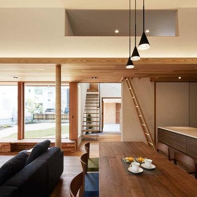 Medium tone wood floor and brown floor great room photo in Nagoya with white walls