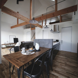 Example of an urban dark wood floor and brown floor great room design in Nagoya with white walls