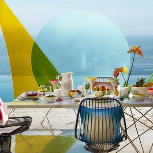 Esempio di una sala da pranzo tropicale