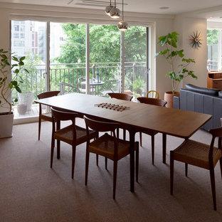 東京23区の北欧スタイルのおしゃれなLDK (白い壁、カーペット敷き、グレーの床) の写真