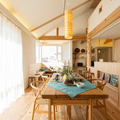 Example of an asian medium tone wood floor and brown floor great room design in Yokohama with white walls