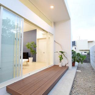 Ispirazione per un patio o portico scandinavo dietro casa con pedane